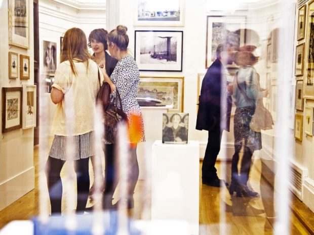 Group of people standing in a gallery