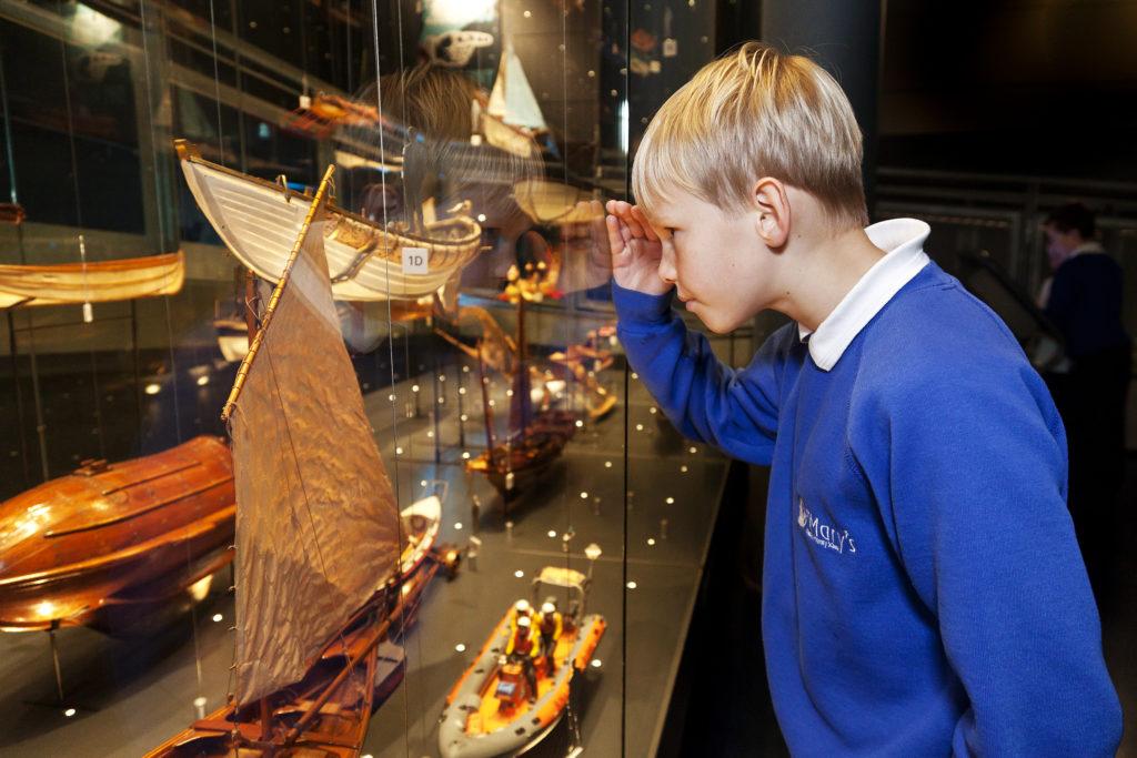 Boy looks at exhibit in case
